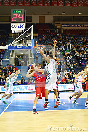 Men from Zalgiris and CSKA Moscow teams play basketball Editorial Photography