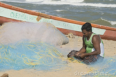 Mending Fishing nets Editorial Stock Image