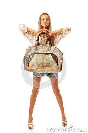 A menina bonita nova com um saco