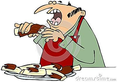 Mens die barbecueribben eten