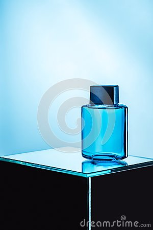 Free Mens Perfume In Blue Spray Bottle, Stock Photography - 120649532