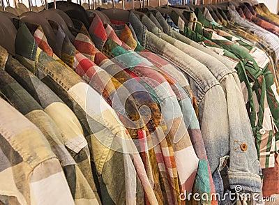 Mens shirts hanging on a rail
