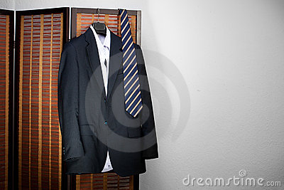 Mens suit hanging on hangers