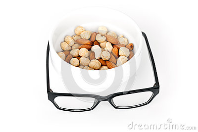 Mental pabulum concept. Nuts and glasses
