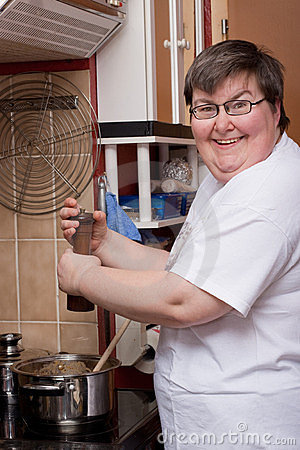 Mentally disabled woman is cooking