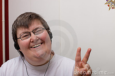 Mentally disabled woman with earphone