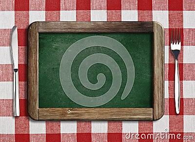 Menu blackboard lying on table