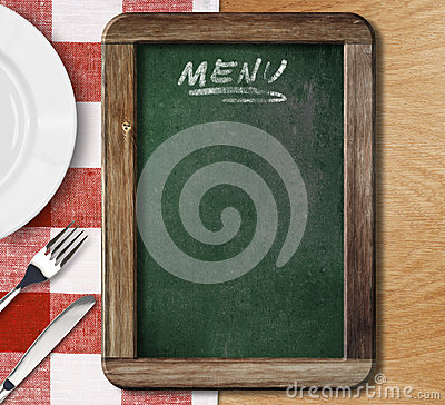 Menu blackboard on red checked tablecloth