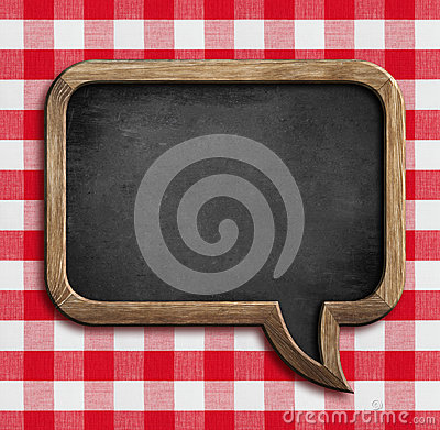 Free Menu Chalkboard Speech Bubble On Picnic Tablecloth Stock Images - 37843674