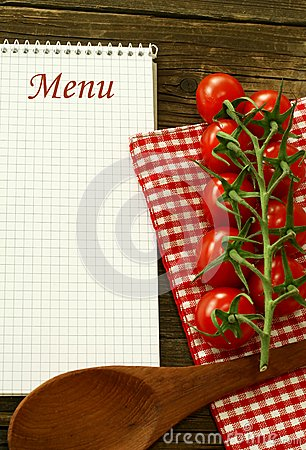 Menu and fresh tomatoes on wooden