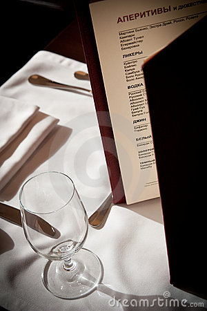 Menu with glass near it