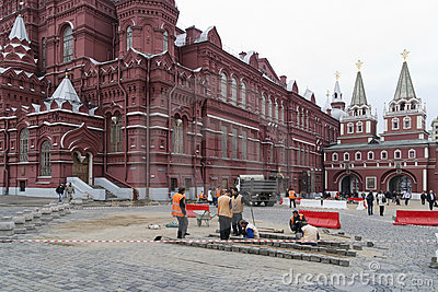 Mercenaries repair a granite  on Red Square Editorial Photo