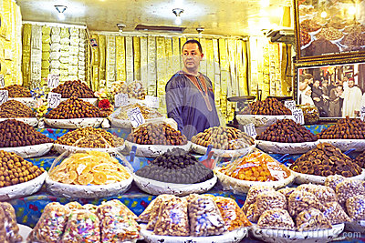 Merchant is selling dried fruit Editorial Stock Photo
