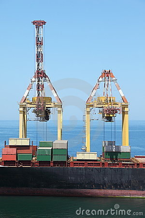 Merchant ship with many big cargos on a board