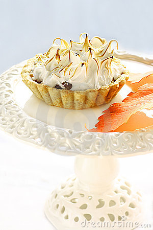 Meringue apple tart on a white cake stand
