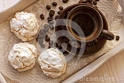 Meringue cookies and cup of aromatic coffee