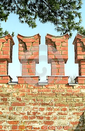 Merlons of red brick wall