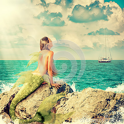 Free Mermaid Sitting On Rocks Royalty Free Stock Images - 54952249