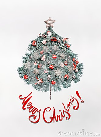 Free Merry Christmas Card With Lettering, Tree Made With Fir Branches, Decorated With Star And Red Festive Decorations , Holidays Cooki Royalty Free Stock Images - 104656479