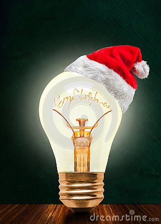 Free Merry Christmas Glowing Light Bulb With Santa Hat And Copy Space Royalty Free Stock Photography - 132852627