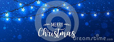Merry Christmas Typographical on blue background with Xmas decorations glowing white garlands, light, stars Stock Photo