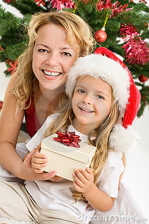 Merry christmas - woman and girl with a present