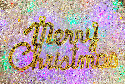 Merry christmas written in gold over ice