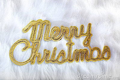 Merry christmas written in gold on white fur