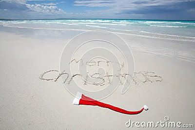 Merry Christmas written on a tropical beach