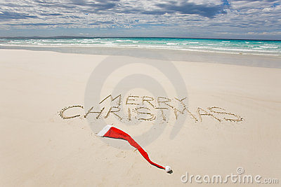 Merry Christmas written on a tropical beach
