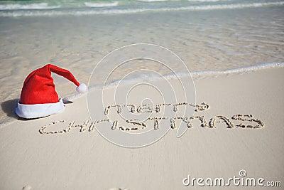 Merry Christmas written on tropical beach white