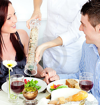 Merry young couple dining at the restaurant