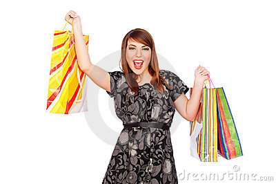 Merry young woman holding shopping bags