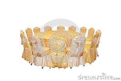 Mesa redonda e cadeiras, um arranjo a jantar