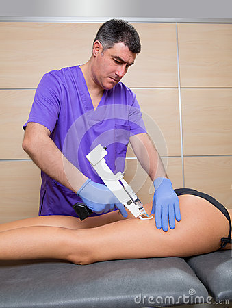 Mesotherapy gun therapy for cellulite doctor with woman