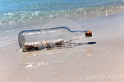 Message ina Bottle on Sandy Shore