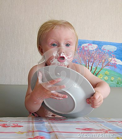 Messy baby with plate