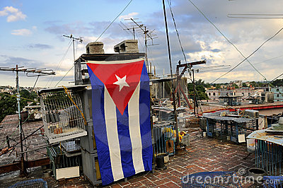 Messy rooftop with cuban flag