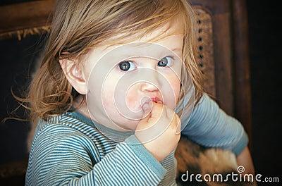 Messy toddler eating