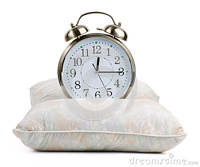 Metal alarm clock on a pillow