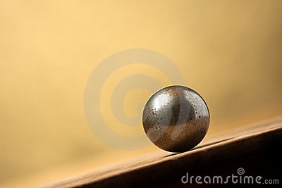 Metal ball on sloping surface
