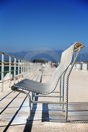 Metal bench on the sea-front