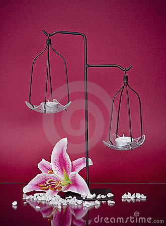 Metal candlestick with two candles and a flower