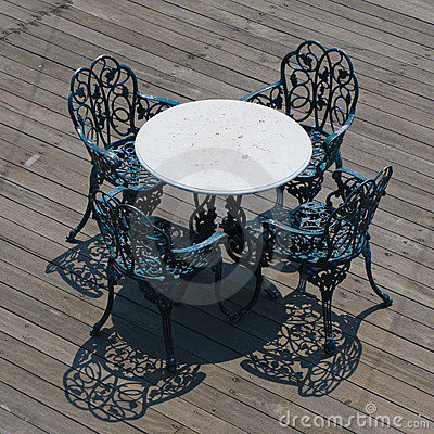 Metal chairs and round table