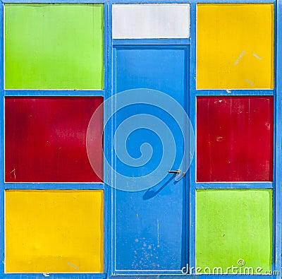 Metal door in colored panels
