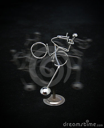 Metal figure riding a bicycle