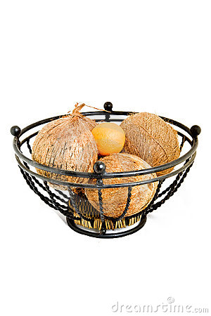 Metal fruit bowl and coconuts