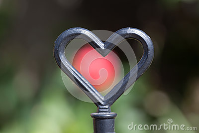 Metal heart in cottage garden