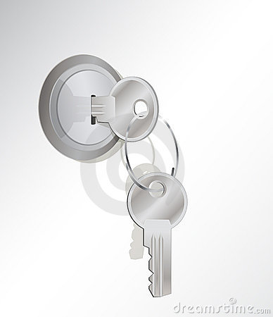 A metal key in a lock. another on the key-ring