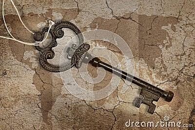 Metal key on map